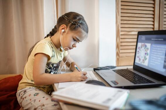 Young student distance learning on laptop