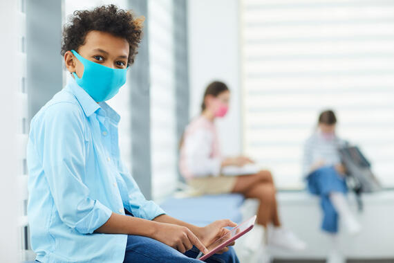 Students learning in school with facemasks